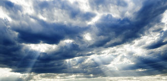 Storm clouds. Sunlights after storm.Storm clouds Royalty Free Stock Images