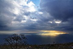 Sunligth  from cloud to sea. Gold color line sunligth rain from cloud to blue  sea in evening in Black sea in Crimea Stock Image