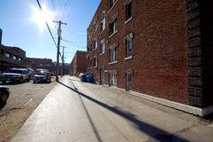 Sunlit Alleyway. The sun shining down an old alleyway Royalty Free Stock Photo