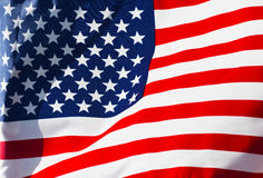 Sunlit American flag in wind. Sunlit American flag in the wind Royalty Free Stock Photos