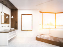 Sunlit bathroom with round tub Royalty Free Stock Photography