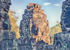 Sunlit Bayon temple statues, Angkor, Cambodia Royalty Free Stock Photos