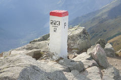 Sunlit Border Marker in Tatra Mountains Stock Image