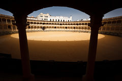 Sunlit circle inside empty bull fight arena Stock Image