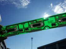 Sunlit Circuit Board. Sunlight shines through a green printed circuit board , which illuminates the circuitry and reveals the connection between points. Great Stock Photo