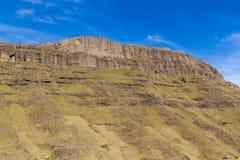 Sunlit Cliffs, Lesotho. Mountain cliffs soaked in sunlight near the Mafika Lisiu Pass in Leribe, Lesotho stock photo