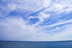 Sunlit clouds. Bright sunlit cloud background showing sun Stock Photo