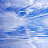Sunlit clouds over water Royalty Free Stock Images