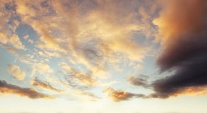 Summer sky. Sunlit clouds in summer sky Royalty Free Stock Photography