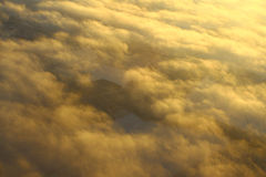 Sunlit clouds, view from altitude Stock Images