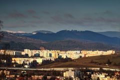 Sunlit colorful tower blocks and mountains in Banska Bystrica royalty free stock photos