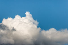 Sunlit cumulus clouds with copy space Stock Photography