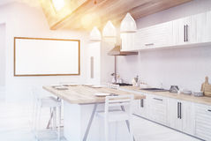 Sunlit dining table in kitchen Stock Photo