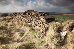Sunlit dry stone wall Stock Image