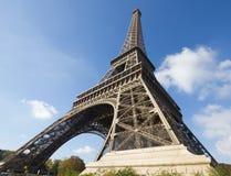 Sunlit Eiffel Tower, Paris, against blue sky Stock Images