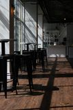 Empty Cafe with afternoon sun. Sunlit empty cafe before the lunch crowd arrives royalty free stock photo