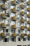 Sunlit facade of high-rise building with balconies Royalty Free Stock Photo