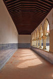 Sunlit gallery, decorated with ceramic tiles Royalty Free Stock Photo