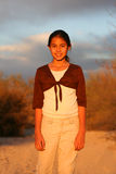 Sunlit girl. Pretty girl standing lit by the sun Royalty Free Stock Images