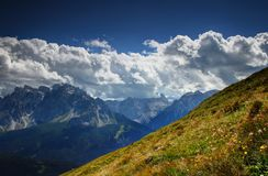 Sexten Dolomites from Carnic Alps sunlit flowered grassy slopes Stock Photography