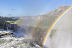 Sunlit Gullfoss waterfall in Iceland with a beautiful double rai royalty free stock images