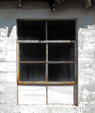 Sunlit Industrial Window Royalty Free Stock Photography