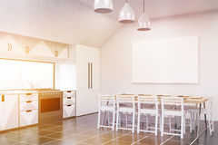 Sunlit kitchen interior with fridge, TV set and gray furniture Stock Photography