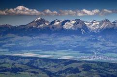 Sunlit Krivan peak and Strbske Pleso resort High Tatra Slovakia royalty free stock photos