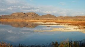 Sunlit Landscape. Panoramic photo of sunlit landscape in Ash Meadows national wildlife refuge in California Stock Photos