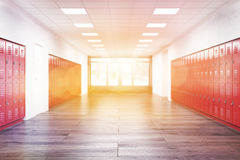 Sunlit lockers in corridor. Red lockers in high school corridor.  Fitness Gym. Concept of learning and education. 3d rendering. Toned image Stock Photo