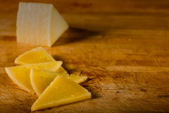 Sunlit Manchego on Wood Royalty Free Stock Image