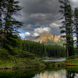 Sunlit mountain. Lake in front of a sunlit mountain in Canada Royalty Free Stock Image