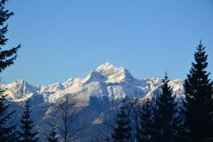 Sunlit mountain peak in winter Royalty Free Stock Photos