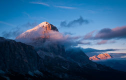 Sunlit mountain tops in chilly atmosphere in Dolomites Royalty Free Stock Images