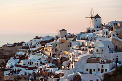 Sunlit Oia village. Oia village at sunset illuminated with sunlight, Santorini, Greece Royalty Free Stock Photo