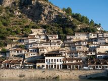 Sunlit Ottoman Houses in Mangalem Quarter of Berat Albania with River Osum in Foreground
