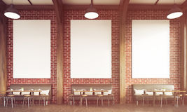Sunlit restaurant with sofas and brick walls. Front view of sunlit restaurant interior with brick walls, sofas, chairs and tables. Concept of eating in public Stock Photo