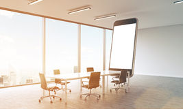 Sunlit room with smartphone Stock Photo