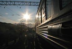 Sunlit Russian train in Siberia Russia, Transiberian. Sunset over the Transiberian railroad in Siberia, Russia Stock Photography