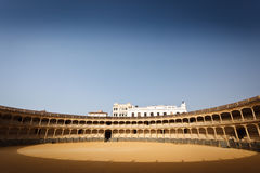 Sunlit seating and floor of bull fight arena Royalty Free Stock Photo