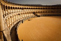 Sunlit side of the empty bullfight arena. Interior view from the top of the sunlit side of the empty bullfight arena in Ronda, Spain Stock Images