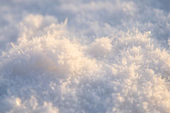 Sunlit snow surface Stock Photos