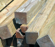 A Sunlit Stack of Damaged Lumber. Royalty Free Stock Photography