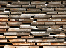 A Sunlit Stacked Pile of Lumber. Royalty Free Stock Image