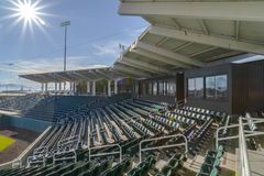 Sunlit tiered seats and rooms at a stadium stock photo