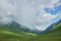 Sunlit valley in the mountains stock image