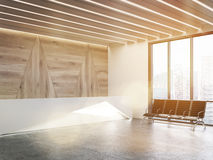 Sunlit waiting area with original reception desk Royalty Free Stock Photo