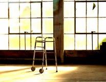 Sunlit Walker. A walker sitting unused in a sunlit room Royalty Free Stock Photos