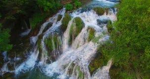 sunlit waterfall stock video