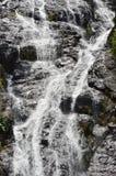 sunlit waterfall Royaltyfri Foto